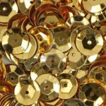 6030501-a-close-view-of-new-gold-sequins-used-for-arts-and-crafts
